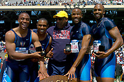 The USA Red men's 4 x 100-meter relay team (from left) of Jon Drummond, Bernard Williams, Darvis Patton and J.J. Johnson on the awards podium with Bill Cosby (center) at the 110th Penn Relays at  the University of Pennsylvania's Franklin Field on Saturday, April 24, 2004 in Philadelphia.