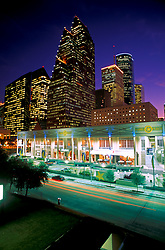 Stock photo of the downtown Houston,Texas skyline at night with Bayou Place in foreground and tallest building Bank of America Center in middle with Pennzoil Place on the left