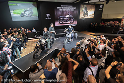 Triumph unveiled 3-models at the Intermot International Motorcycle Fair in Cologne, Germany with the biggest news being that they made improvements to the 900cc parallel twin fitted in the Bonneville, like giving it a 10 hp upgrade and raising the redline. Then they roared out with a bike fitted with their Moto2 prototype race engine that they will be campaigning on the Moto GP circuit that sounded amazing! In the photo is Miles Perkins (head of brand Management) who hosted the ceremony with actor and Triumph enthusiast John Friedmann on the left bike and Dutch Van Someren, the founder of the Bike Shed MC (and shop) of London on the Street Scrambler on the right for which he designed the one-off tank. Tuesday October 2, 2018. Photography ©2018 Michael Lichter.