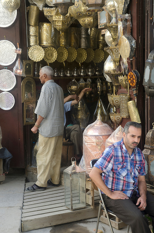 Shop with brass lamps and dishes in Fes medina Morocco