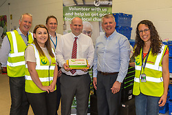 FareShare CEO Jim Duncan centre, and Operations Manager Paul Underdown, second right, with team members at the opening of FareShare's relocated warehouse in Ashford, Kent. Ashford, Kent, May 23 2019.