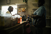 PANOLA, AL – OCTOBER 9, 2015: A family drops into R&D's General Store, the only store where food is sold in Panola. Due to state budget cuts, Alabama announced the closure of 31 of its driver's license offices in mostly rural sections of the state, where poverty is high and transportation is notoriously difficult. Critics argue the closures are an attempt to limit accessibility to photo IDs – which are now required for voting – but state officials insist that the closings have no effect on access to photo ID. CREDIT: Bob Miller for The New York Times