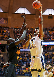 Jan 12, 2019; Morgantown, WV, USA; West Virginia Mountaineers forward Derek Culver (1) shoots during the second half against the Oklahoma State Cowboys at WVU Coliseum. Mandatory Credit: Ben Queen-USA TODAY Sports