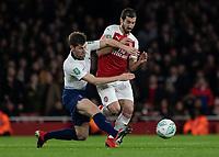Football - 2018 / 2019 EFL Carabao Cup (League Cup) - Quarter-Final: Arsenal vs. Tottenham Hotspur<br /> <br /> Ben Davies (Tottenham FC)  with a tackle on Henrikh Mkhitaryan (Arsenal FC) at The Emirates.<br /> <br /> COLORSPORT/DANIEL BEARHAM