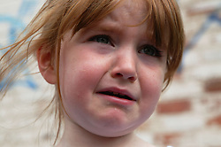 Close up of a young girl crying,