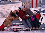 Sophia Ahmaogak, Krystle Ahmaogak and Lorraine Tagarook, Inupiat children on the seat of the Ahmaogak's Polaris snowmobile, village of Wainwright, Arctic Coast of Alaska.