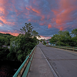 Sunset abovethe bridge over the Connecticut River between Beecher Falls, Vermont and Stewartstown, New Hampshire.