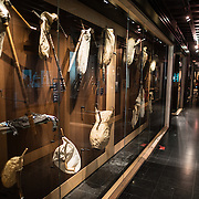 Variations on traditional bagpipes on display at the Musical Instrument Museum in Brussels. The Musee des Instruments de Musique (Musical Instrument Museum) in Brussels contains exhibits containing more than 2000 musical instruments. Displays include historical, exotic, and traditional cultural instruments from around the world. Visitors to the museum are given handheld audio guides that play musical demonstrations of many of the instruments. The museum is housed in the distinctive Old England Building.