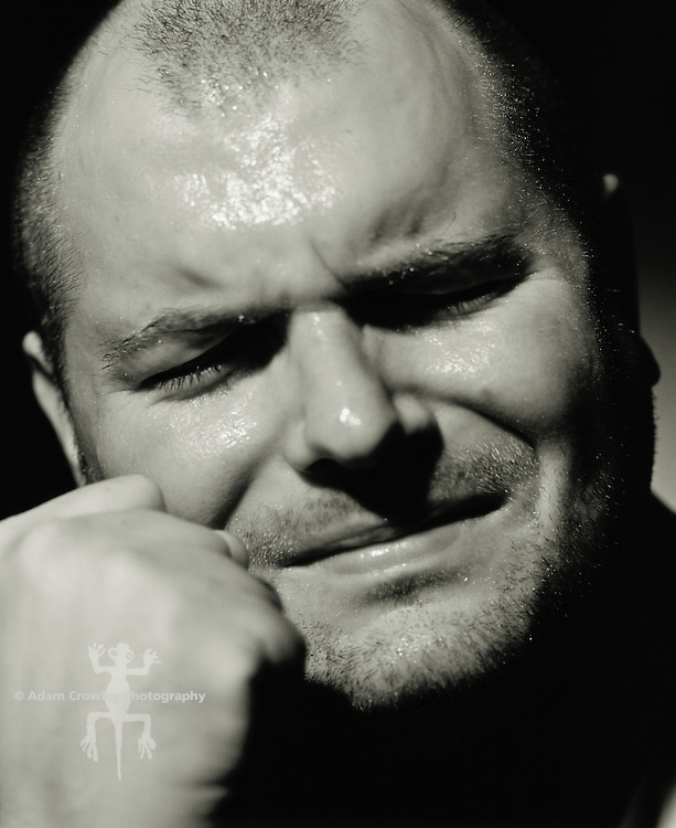 Middle-aged adult white male (30-35 years old) crying, close-up (B&W)