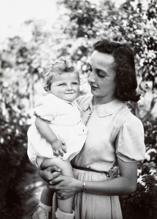 girl posing with toddler in garden France 1900s