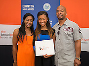 Alexandria Jones, center, of Westside High School poses for a photograph after receiving a $20,000 scholarship from the Broad Foundation following a research team tour at Ortiz Middle School, May 29, 2013.