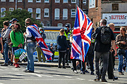 Far-right anti-immigration protesters after being dispersed by Kent Police after some of them clashed earlier in Dover on Saturday, Sept 5, 2020. At least 100 officers were at the scene on the A20 while protesters block the road and shout 'England 'till I die'. Fears of violence were voiced and local MP Natalie Elphicke pleaded for people to 'stay away' over COVID fears. Several officers were seen restraining one person on the ground before arresting them near Dover Marina. (VXP Photo/ Vudi Xhymshiti)