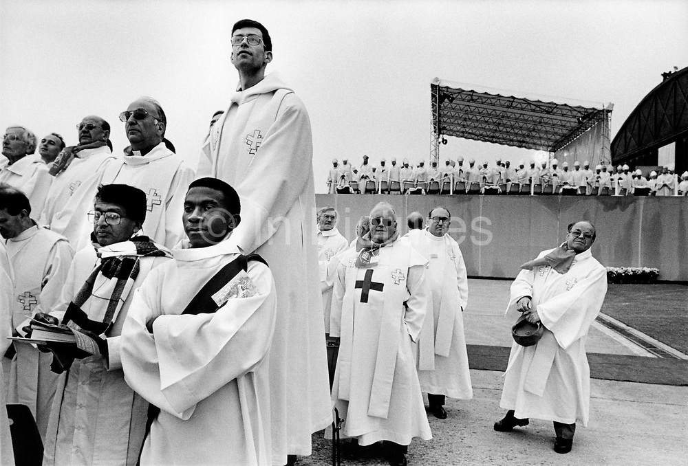 Pope's visit to France, September 1996. Catholic priests awaiting the arrival of the Pope. 200,000 people attend an open air mass at Reims