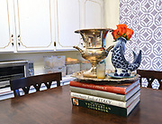"""Cookbooks and decorations atop the kitchen table. Photo taken on January 8, 2019 for """"At Home"""" feature on Sandy Stolberg, who uses dollar store finds as part of the decorations in her Belleville, IL condo.<br /> Photo by Tim Vizer"""