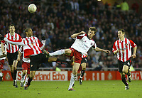 Photo. Andrew Unwin.<br /> Sunderland v Sheffield United, FA Cup Sixth Round, Stadium of Light, Sunderland 07/03/2004.<br /> Sheffield United's Michael Tonge (c) gets stuck in with Sunderland's Phil Babb (l).