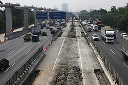 August 29, 2017 - Bekasi, West Java, Indonesia - Traffic density on the Jakarta-Cikampek toll road, in Bekasi Timur, Bekasi, West Java, August 29, 2017. The government, through the Ministry of Transportation plans to test the implementation of odd-even system in the Jakarta-Cikampek toll to overcome the density of vehicles ongoing development project of LRT and construction of toll of Jakarta-Cikampek II (Elevated). However, the test plan is declared pending in the context of an in-depth study of the system. The government's plan could reap a lot of protest from the community as well as plans to expand the ban on motorcycles in the street protocol that is considered discriminatory. (Credit Image: © Aditya Irawan/NurPhoto via ZUMA Press)