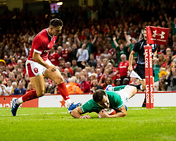 Jacob Stockdale of Ireland scores his sides first try<br /> <br /> Photographer Simon King/Replay Images<br /> <br /> Friendly - Wales v Ireland - Saturday 31st August 2019 - Principality Stadium - Cardiff<br /> <br /> World Copyright © Replay Images . All rights reserved. info@replayimages.co.uk - http://replayimages.co.uk
