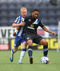 David Perkins of Wigan Athletic (L) and Liam Feeney of Blackburn Rovers in action - Mandatory by-line: Jack Phillips/JMP - 13/08/2016 - FOOTBALL - DW Stadium - Wigan, England - Wigan Athletic v Blackburn Rovers - EFL Sky Bet Championship