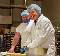 Pictured: Assistant bakery manager Mickey Wilson keeps a clo0se eye on Willie Rennie<br /><br />Scottish Liberal Democrat leader Willie Rennie was busy making pies and bridies today while discussing how voters stop a second independence referendum on a visit to Stuart Bakery. in  Methil<br /><br />Ger Harley | EEm 6 December 2019