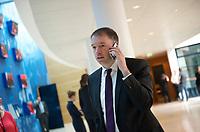 DEU, Deutschland, Germany, Berlin, 24.03.2014:<br />Niels Annen (MdB, SPD) telefoniert mit seinem Smartphone vor einer Sitzung des SPD-Parteivorstands im Willy-Brandt-Haus.