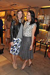 Left to right, SERENA NIKKAH and JULIET ANGUS at a champagne breakfast hosted by Carolina Gonzalez-Bunster and TOD's in aid of the Walkabout Foundation held at TOD's, 2-5 Old Bond Street, London on 9th May 2013.
