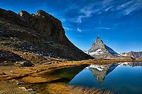 The Matterhorn reflecting in lake Riffelsee near Zermatt, Switzerland