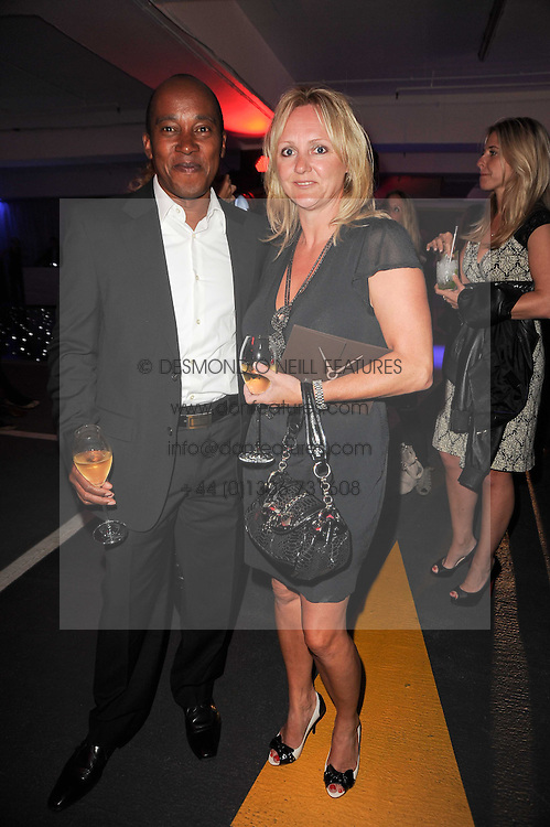 ANTHONY HAMILTON and his wife LINDA at a party to celebrate 150 years of TAG Heuer held at the car park at Selfridge's, London on 15th September 2010.