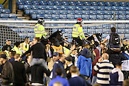 Police on horseback move  fans  back during a pitch invasion after full time. Skybet football league one play off semi final 2nd leg match, Millwall v Bradford city at The New Den in London on Friday 20th May 2016.<br /> pic by John Patrick Fletcher, Andrew Orchard sports photography.