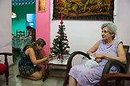 A family prepares a Christmas tree at their home in Havana, Cuba. (December 17, 2014)