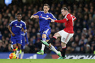 Wayne Rooney, the Manchester United captain is intercepted by Nemanja Matic of Chelsea. Barclays Premier league match, Chelsea v Manchester Utd at Stamford Bridge in London on Sunday 7th February 2016.<br /> pic by John Patrick Fletcher, Andrew Orchard sports photography.