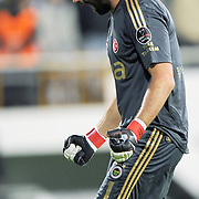 Fenerbahce's goalkeeper Volkan DEMIREL celebrate goal during their Turkish Superleague Derby match Besiktas between Fenerbahce at the Inonu Stadium at Dolmabahce in Istanbul Turkey on Thursday, 207 October 2011. Photo by TURKPIX