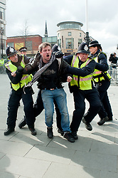 """Protestor is grabbed by police after crossing the """"Ring of Steel"""" fence in Barkers Pool, outside Sheffield city Hall where the Liberal Democrats are holding their Party conference Conference Sheffield Saturday<br /> 12 March 2011<br /> Images © Paul David Drabble"""