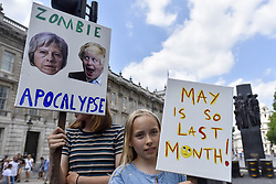 June 17, 2017 - London, UK - London, UK. Demonstrators gather outside Downing Street to protest against Theresa May following the results of the General Election, the Conservatives' proposed coalition with the DUP and the Grenfell Tower fire tragedy. (Credit Image: © Stephen Chung/London News Pictures via ZUMA Wire)