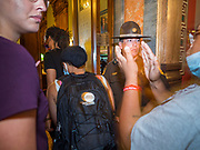 15 JUNE 2020 - DES MOINES, IOWA: An Iowa State Trooper watches Black Lives Matter protesters go into the Governor's Reception Room during a protest in the Iowa capitol in Des Moines. About 75 supporters of Black Lives Matter marched through the Iowa capitol Monday to demand the restoration of voting rights for felons who have completed their sentences. Iowa is one of only two states in the US that permanently strip felons of voting rights. The issue is a  racial one in Iowa. Blacks make up only 4 percent of the population but 25 percent of the prison population. The Governor agreed to meet with a delegation of the protesters but she would not commit to immediately restoring voting rights. She said would draft an executive order to restore voting rights later in the summer.    PHOTO BY JACK KURTZ