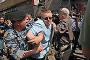 Moscow, Russia, 27/05/2007..Riot police arrest a gay acivist during Moscow's second attempted Gay Pride parade. The parade had already been banned by Moscow Mayor Yuri Luzhkov on the grounds that it would provoke violence, but gay activists attempted to demonstrate in defiance of the ban, and many were beaten by counter demonstrators and arrested by police.