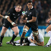 Ma'a Nonu, New Zealand, is tackled by Vincent Clerc, France, during the New Zealand V France, Pool A match during the IRB Rugby World Cup tournament. Eden Park, Auckland, New Zealand, 24th September 2011. Photo Tim Clayton...