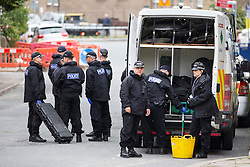 © Licensed to London News Pictures. 17/06/2016. Birstall UK. Police arrive to conduct more searches at the scene in Birstall market place this morning where MP Jo Cox was murdered yesterday. Photo credit: Andrew McCaren/LNP