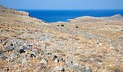 Brown barren limestone hillside summer drought, Rhodes, Greece near Lindos