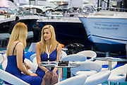 Hoistesses await the rush of visitors. The CWM FX London Boat Show, taking place 09-18 January 2015 at the ExCel Centre, Docklands, London. 09 Jan 2015.