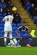 M K Dons Joe Walsh (l) wins the ball from Cardiff City's Sammy Ameobi. Skybet football league championship match, Cardiff city v MK Dons at the Cardiff city stadium in Cardiff, South Wales on Saturday 6th February 2016.<br /> pic by Carl Robertson, Andrew Orchard sports photography.