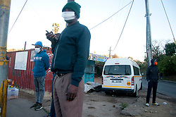 Taxi marshals  wearing masks at a taxi rank in Mayville, Durban, South Africa.