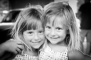 Two twin sisters having fun in front of the camera. Missoula Photographer