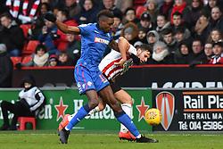 Sheffield United's George Baldock and Bolton Wanderers' Sammy Ameobi battle for the ball