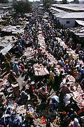 The fresh meat section of the weekly market in Hargesia, the capital of Somaliland. Despite the chronically chaotic political situation, people still try to go about their ordinary lives whenever they can, in this case buying and selling beef, mutton, and camel meat. Hungry Planet: What the World Eats (p. 17). Somaliland is the breakaway republic in northern Somalia that declared independence in 1991 after 50,000 died in civil war. March 1992.