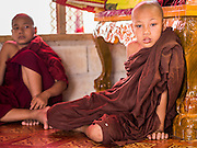 25 MAY 2013 - MAE SOT, TAK, THAILAND: Burmese novices in their temple in an unofficial village of Burmese refugees north of Mae Sot, Thailand. They live on a narrow strip of land about 200 meters deep and 400 meters long that juts into Thailand. The land is technically Burma but it is on the Thai side of the Moei River, which marks most of the border in this part of Thailand. The refugees, a mix of Buddhists and Christians, settled on the land years ago to avoid strife in Myanmar (Burma). For all practical purposes they live in Thailand. They shop in Thai markets and see their produce to Thai buyers. About 200 people live in thatched huts spread throughout the community. They're close enough to Mae Sot that some can work in town and Burmese merchants from Mae Sot come out to their village to do business with them.   PHOTO BY JACK KURTZ