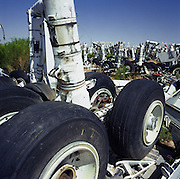 In mid-day heat of the arid Arizona desert, a complete set of main landing gear undercarriage stands upright amid a field of similar items from airliners at the storage facility at Davis Monthan, Tucson. Here, the fate of the world's retired civil airliners is decided by age or cooling economy. Cannibalised for still-working parts or recycled for scrap, their aluminium is worth more than their sum total. Elsewhere, assorted aircraft wrecks sit abandoned in the scrub minus their bellies, legs or wings like dying birds. After a lifetime of safe commercial flight, wings are clipped and cockpits sliced apart by huge guillotines, cutting through their engineering. Picture from the 'Plane Pictures' project, a celebration of aviation aesthetics and flying culture, 100 years after the Wright brothers first 12 seconds/120 feet powered flight at Kitty Hawk,1903.