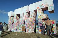 Mandatory Credit: Photo by STEVE MEDDLE / Rex Features<br /> 'LOVE' SCULPTURE<br /> GLASTONBURY FESTIVAL DAY 2, BRITAIN - 28 JUN 2003<br /> <br /> PEOPLE GRAFFITI