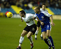 Photo. Chris Ratcliffe<br />Millwall v Derby County. FA Nationwide 1st Division. 22/11/2003<br />Adam Bolder of Derby and Robbie Ryan of Millwall have all eyes on the ball