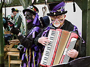 Musicians from Rack-a-back Morris Men at an orchard-visiting wassail in Kilham village, Yorkshire Wolds, UK on 21st January 2017. Wassail is a traditional Pagan winter celebration in cider-producing regions of England, reciting incantations and singing to the trees to promote a good harvest for the coming year. Pieces of toast soaked in cider are hung in the branches to attract robins to the tree as these are said to be the good spirits of the orchard. To ward off evil spirits, villagers scare them away by banging pots and pans and making as much noise as possible