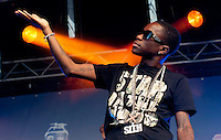 Tinchy Stryder performs live on stage. Photograph for show organiser PR and case study.